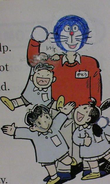 Photos: 英語の教科書の挿絵に修正テープを用いた高度な落書きシリーズ?:かと...